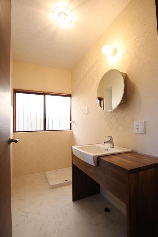 洗面、脱衣所、洗濯機置き場、お風呂をひとつの空間としました。