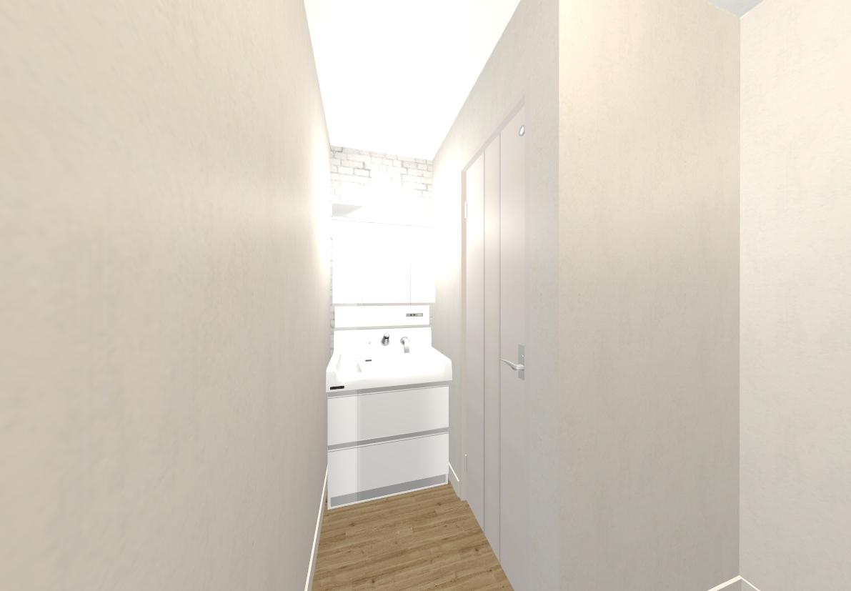 コンパクトなスペースの洗面所は通常より大きめの洗面台で収納を確保しました。